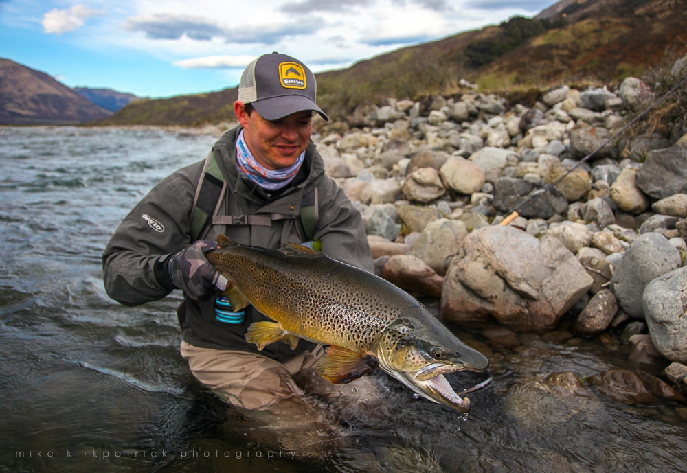 Happy angler with trout
