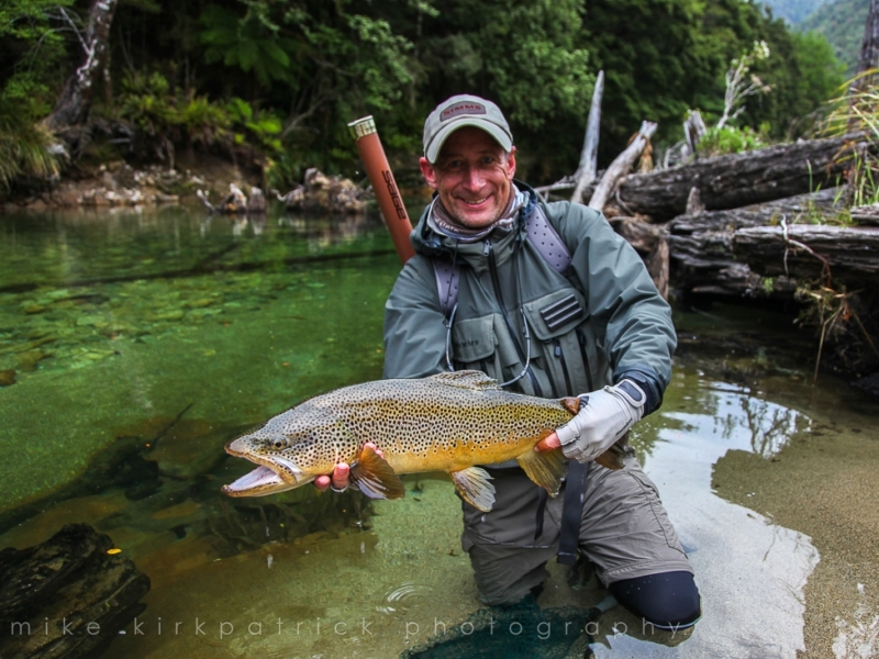 Angler holding trout with big smile