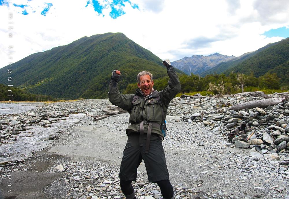 Angler celebrating on river